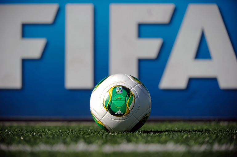 The official match ball for the 2013 Confederations Cup tournament is placed on a pitch at the FIFA headquarters in Zurich on September 3, 2013.   AFP PHOTO / SEBASTIEN BOZON        (Photo credit should read SEBASTIEN BOZON/AFP/Getty Images)