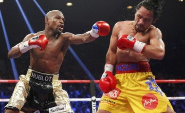 Floyd Mayweather, Jr. of the U.S. lands a left to the face of Manny Pacquiao of the Philippines (R) in the 11th round during their welterweight WBO, WBC and WBA (Super) title fight in Las Vegas, Nevada, May 2, 2015.    REUTERS/Steve Marcus ORG XMIT: LAV54