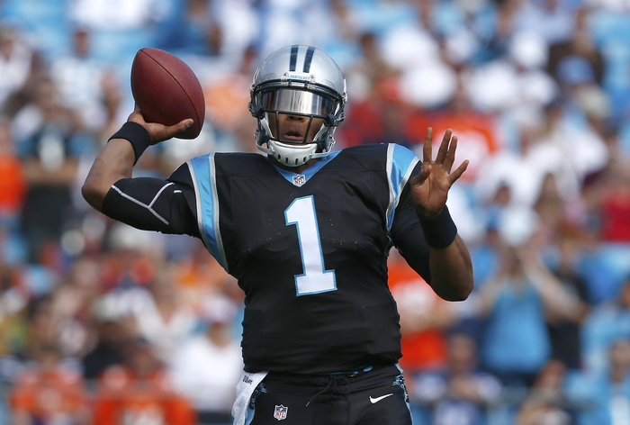 Carolina Panthers quarterback Cam Newton throws a pass against the Denver Broncos during an NFL football game in Charlotte